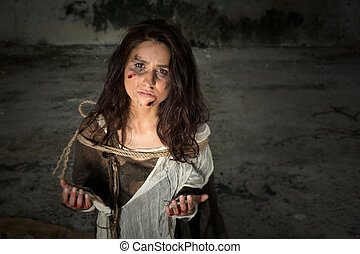 Misery - Homeless young woman dressed in rags in a derelict...