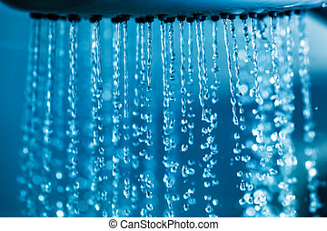 Clear water flowing from shower. - Clear water flowing from...