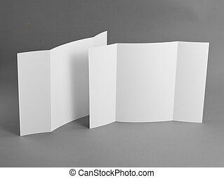 Blank gate fold brochure on grey to replace your design.