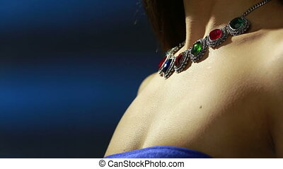 necklace on the neck. ruby and emerald - necklace on the...