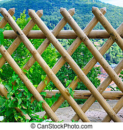 a wooden slatted fencing