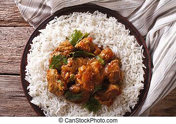 Indian Madras beef with basmati rice closeup. Horizontal top...