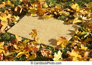 Carpet lying on the grass in autumn