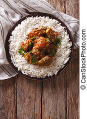 Indian food: Madras beef with basmati rice. vertical top...