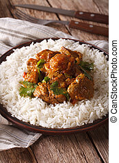 Indian cuisine: beef madras with basmati rice close-up on a...