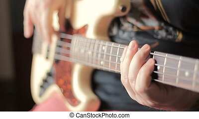 Man with Tatoo playing bass guitar - Guitarist with Tatoo...