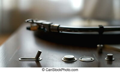 Turntable Spinning vinyl record - Player on and listening to...