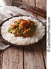 Beef Madras with basmati rice close-up. Vertical - Beef...