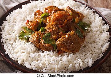 Indian cuisine: beef madras with basmati rice close-up...