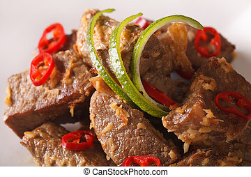 Beef rendang with coconut and spices macro. Horizontal -...