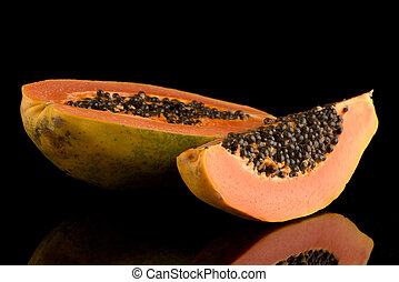 Fresh and tasty papaya on black background