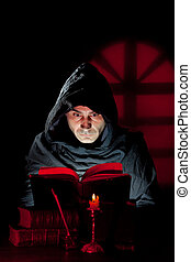 Monk read a book - A Monk read mystical occult book in the...