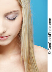 blonde girl\'s half-face portrait - half-face portrait of...