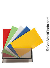 Blank colorful business cards spread out, in holder