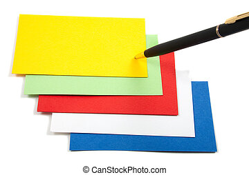 Blank colorful business cards spread out, with pen