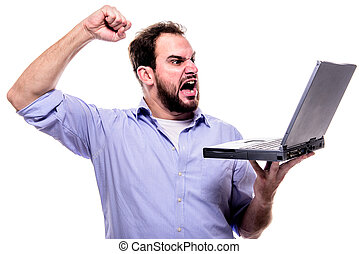 Mad at laptop - Bearded man shouting angrily at his laptop...