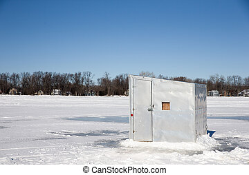 Ice Shanty on a Frozen Lake - A lone ice shanty sitting on a...