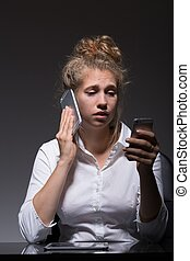 Spending time with phones - Young woman is spending time...