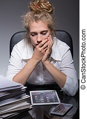 Worried about job - Young woman is very worried about her...