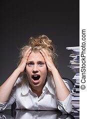 Paperwork after hours - Woman has to do paperwork after...
