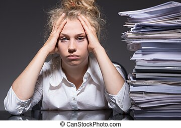 Paperwork in the office - Young woman has lots of paperwork...