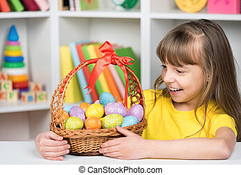 Little girl with basket of Easter eggs - Beautiful little...
