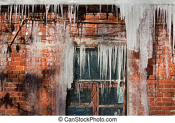 Icicle - Cold snow winter frozen ice melting icicle on wall