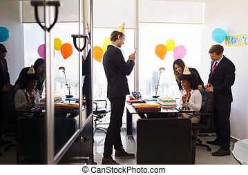 Woman Celebrates Birthday Party In Business Office With...