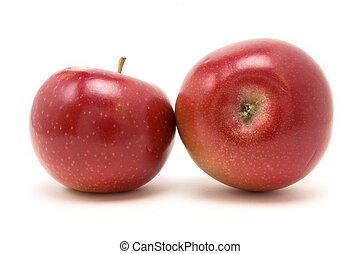 Red macintosh apple from low viewpoint isolated against...