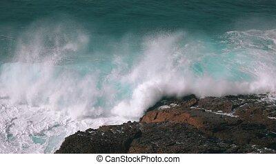 Ocean Waves Breaking on Rock, slow motion