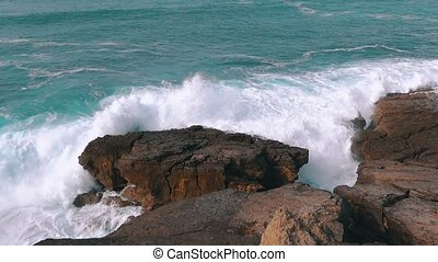 Ocean Waves Breaking on Rock, slow motion