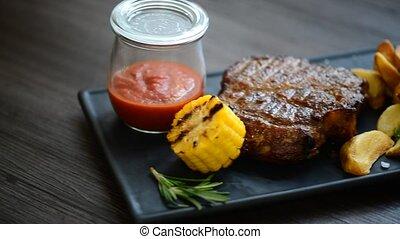 pork steak served with red sauce - meat dish : pork steak...