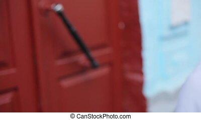 The guy opens the red door