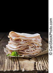 Heap of sliced Chicken Breast Fillet selective focus;...
