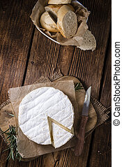 Camembert close-up shot on an old rustic wooden table
