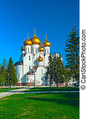 Ancient ortodox christian curch with golden domes in sunny...