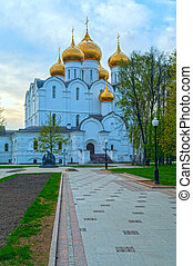 Ancient ortodox curch with golden domes in cloudy evening -...