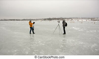 photographers photographed each other - two photographers...