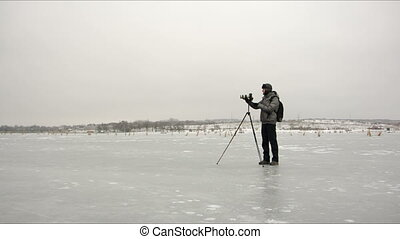 photographer on the ice - the photographer is standing on...