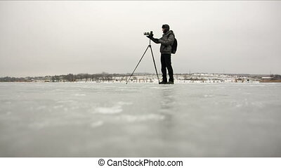 the photographer on the ice - the photographer is standing...