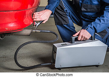 A diagnostic sensor is applied to the ehaust of a car by a...