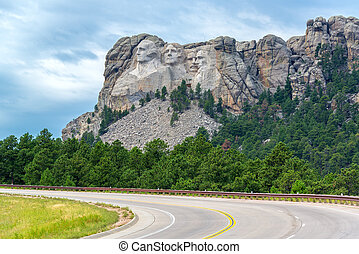Highway and Mount Rushmore - View of a highway leading to...