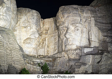 Mount Rushmore at Night - Mount Rushmore at night with...