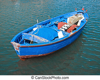 Rowboat in blue sea.