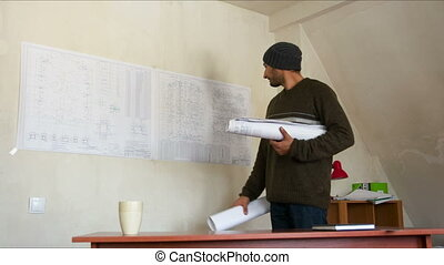 engineer with blueprints in the workplace