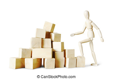Man climbing to the stack of blocks. Abstract image with a wooden puppet