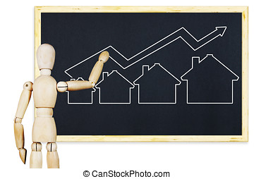 Man draws a graph of real estate sales growth on a blackboard. Abstract image with wooden puppet