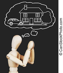 Man is praying about a house and welfare. Abstract image with wooden puppet