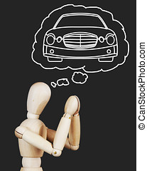 Man is praying about new luxury car. Abstract image with wooden puppet