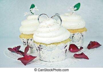 wedding rings in cupcake - Pair of wedding rings in icing on...
